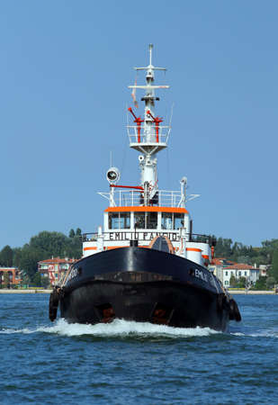 tugboat: Venice, VE - Italy. 14th July, 2015:  powerful tugboat used to drive large cruise ships away from the harbor of Venice island along the giudecca Canal