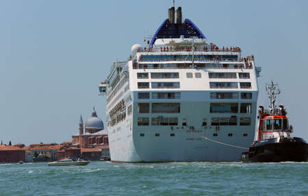 tugboat: Venice, VE - Italy. 14th July, 2015:  powerful tugboat used to drive huge cruise ships away from the harbor of Venice island along the giudecca Canal Editorial