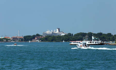 saint mark square: Venice, VE - Italy. 14th July, 2015: huge cruise ship in the Canale della Giudecca near Saint Mark Square  and other boats in venetian lagoon