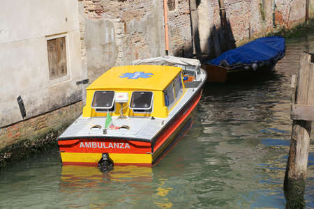 boat accident: Venice, VE - Italy. 14th July, 2015: ambulance ship moored in a canal of Venice island during a medical emergency in venetian lagoon
