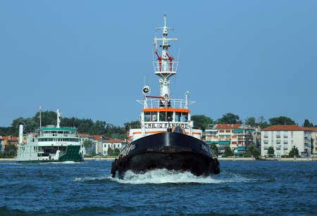 tugboat: Venice, VE - Italy. 14th July, 2015: powerful tugboat used to drive large cruise ships away from the harbor ort of Venice Island across the canale della giudecca Editorial