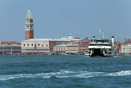 ve: Venice, VE - Italy. 14th July, 2015: Ferry of ACTV company of Venice  to transport cars and vehicle from Venice Island to Venice Lido and Saint Mark Bell Tower