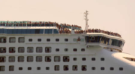 saint mark square: Venice, VE - Italy. 14th July, 2015: huge cruise ship in the Canale della Giudecca near Saint Mark Square with many tourists on board