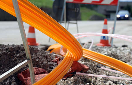 road excavation for the laying of optical fiber for very high speed internet Imagens