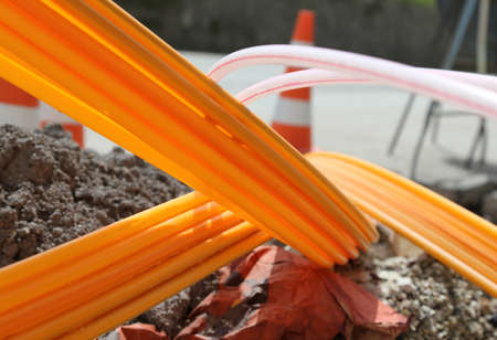 high speed internet: Many Orange pipes for fiber optics in a large city road construction to connect high speed internet