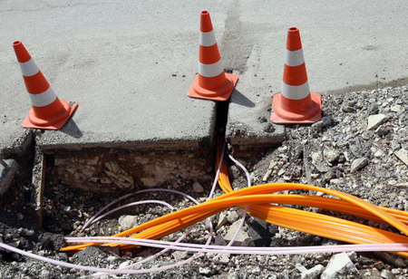high speed internet: Road construction with pipes for laying optical fiber for high speed internet Stock Photo