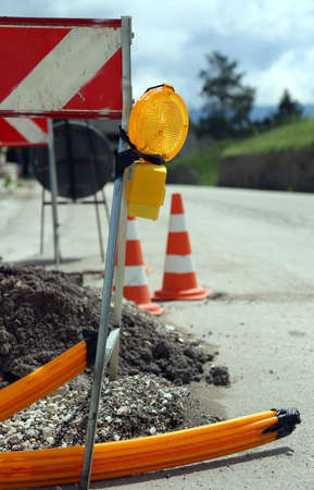 fiber optic lamp: lamp in road construction for laying telecommunications infrastructure in optical fiber Stock Photo