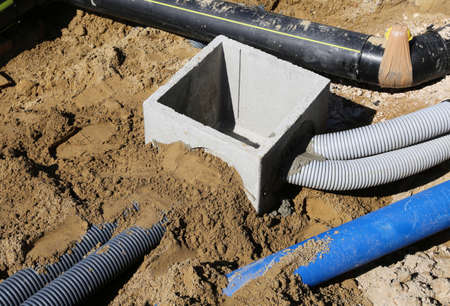 corrugated pipes for electrical cables and a cockpit in concrete in the excavation in road construction