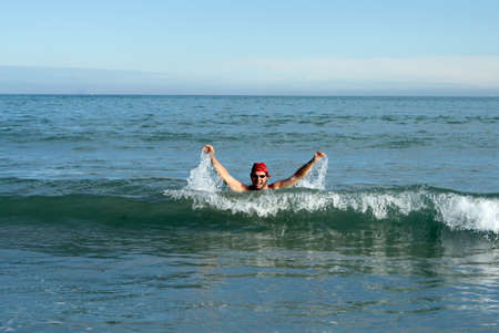 red bandana: Person with red bandana In the waves of the sea while having fun