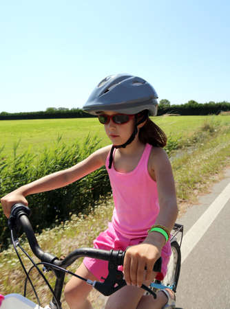 eight year old: eight year old girl goes to bike with grey helmet