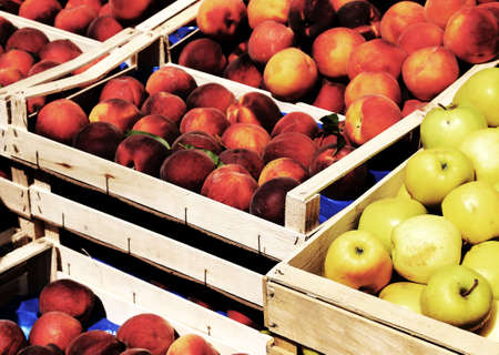 fruit market: boxes of apples and peaches for sale at market fruit in summer Stock Photo