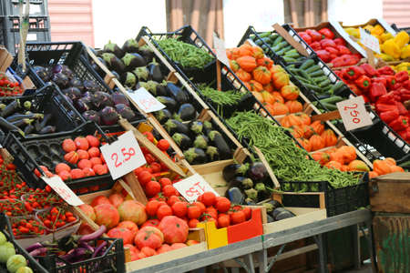 fruit market: large fruit and vegetable stand with seasonal fruits in the local market of the city Stock Photo