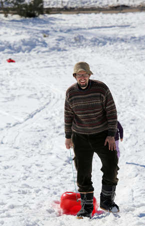 bob: man with Hat and bob on the snow in the mountains in winter Stock Photo