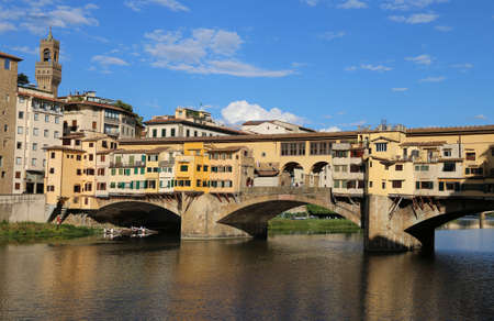 arno: Florence Italy houses and shops in the ancient bridge called Ponte Vecchio over River Arno Stock Photo