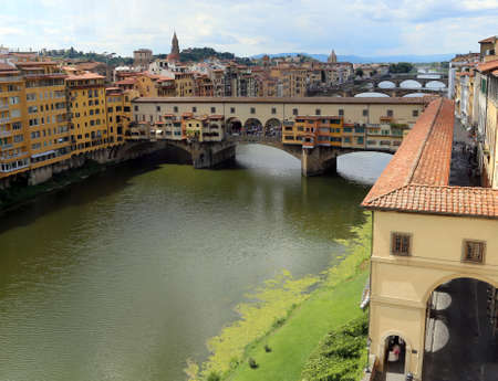 river arno: Florence Italy houses and shops in the ancient bridge called Ponte Vecchio over River Arno Editorial