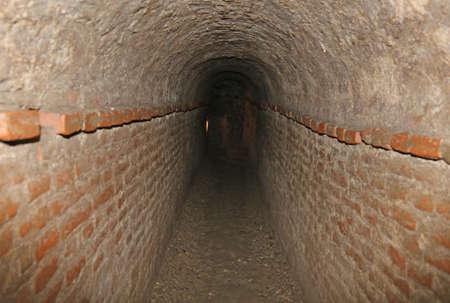 passage: long brick tunnels of a secret underground passage