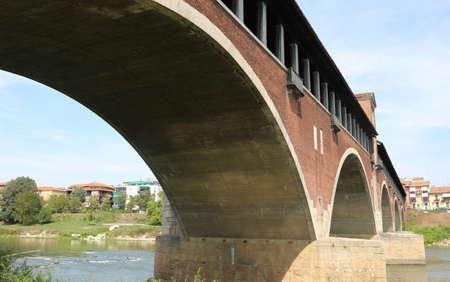 historian: covered bridge over the TICINO River in Pavia City in Italy