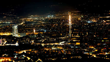dark city: night aerial view of the populous European metropolis with many city lights Stock Photo