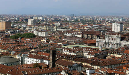 overbuilding: panoramic view from the top by the city of Turin in Italy with the historic Palace called Palazzo Carignano Editoriali