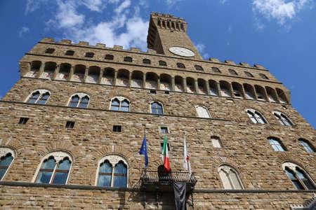 signoria square: Florence Italy Historic clock tower building called Palazzo Vecchio in the Signoria square Editorial