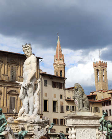 signoria square: White statue of Neptune in the ancient fountain in Florence Italy