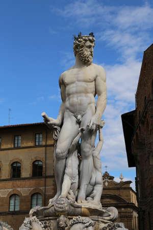 signoria square: White statue of Neptune in the ancient fountain in Florence ITALY  in Piazza della Signoria