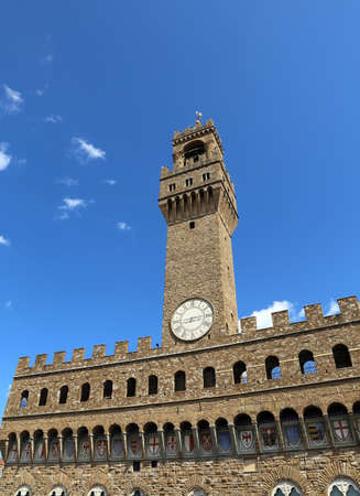 signoria square: Florence Italy Old Palace called Palazzo Vecchio and clock tower with blue sky in Signoria square Editorial