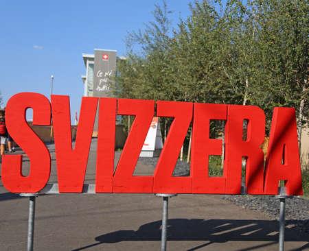 exposition: MI, Italy - 8th September, 2015. Expo Milan 2015 Universal Exposition. Big red Written SVIZZERA in the Switzerland Pavilion Editorial