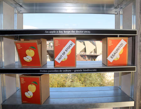 smallness: Milan, Italy - 8th September, 2015. Expo Milan 2015 Universal Exposition. Inside the Tower of Swiss Pavilion. Many boxes with apples. All visitors of Expo could take all apples they wanted, But for people who come after, there would be no more existed app