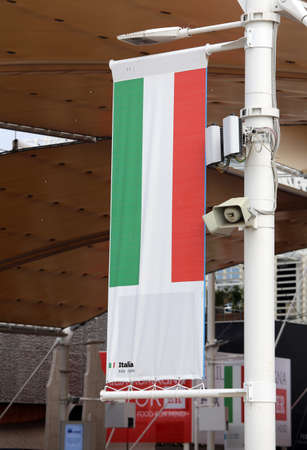 exposition: Milan, Italy - 8th September, 2015. International Exposition EXPO MILANO 2015. Detail of Italian Pavilion and flag