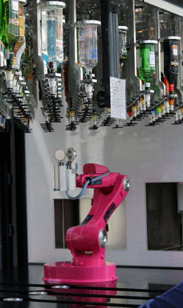 Milan, Italy - 8th September, 2015. EXPO MILANO 2015. Robot arm and bottles of spirits for the preparation of customized drinks automatically