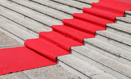 red carpet event: long staircase with a red carpet to welcome VIPs