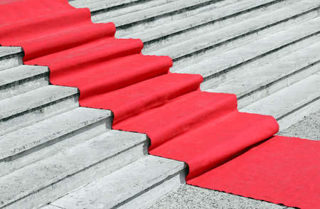 luxurious: long staircase with a luxurious red carpet to welcome VIPs