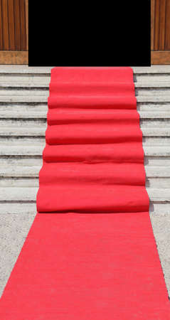 black carpet: long staircase with a luxurious red carpet toward the open door of the building