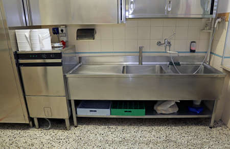 large stainless steel sink of industrial kitchen for preparing food Stockfoto