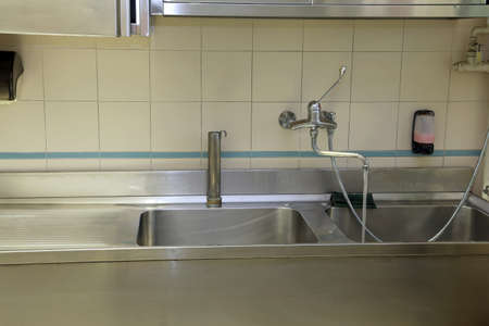 industrial kitchen: large stainless steel sink of industrial kitchen for preparing food for many people