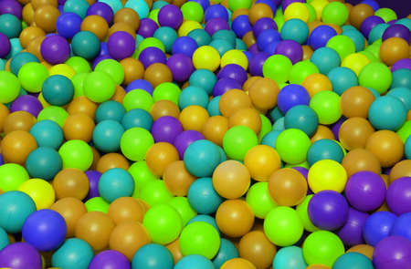 entertaining: background of many colored plastic balls in an entertaining childrens pool