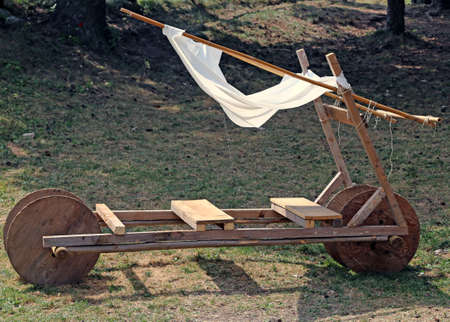 ���stone age���: funny acnient stone age car made of wood Stock Photo