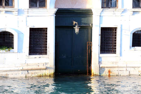 the flood tide: Venice palace in Canal Grande during high tide