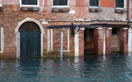 the flood tide: Venice house in Canal Grande during high tide Editorial