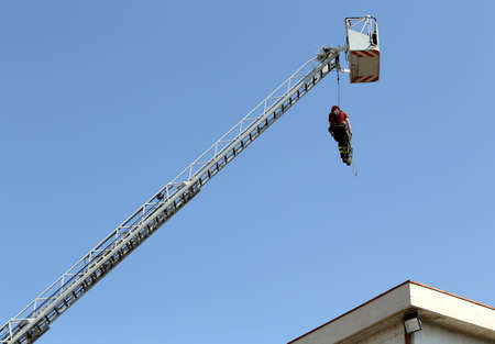 rappel: firefighter hung the rope climbing during the fire tutorial Stock Photo