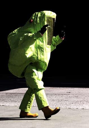 hazardous: person with yellow protective suit to manage hazardous materials