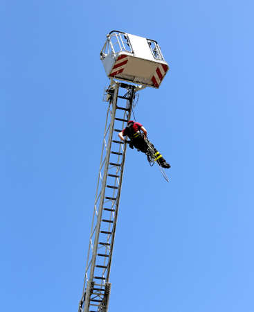 practical: firefighters hung the rope climbing during the practical exercise in firehouse