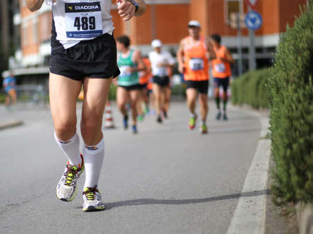 legs around: Vicenza, Italy. 20th September 2015.  Marathon runners during the race called Mezza di Vicenza in city street of Vicenza in Northern Italy.The runners have raced meters 21097
