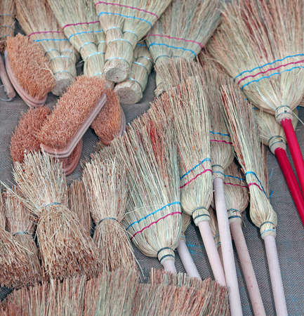 sales person: brooms and brushes of sorghum in retail market