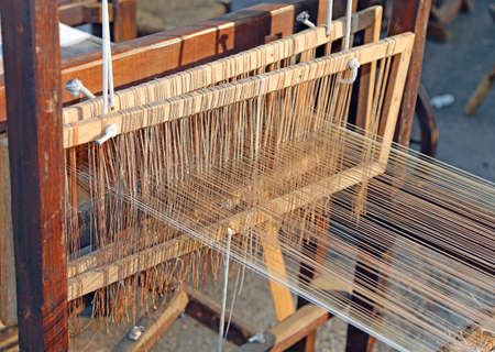 carding: wooden Spinning frame for textile processing Stock Photo