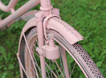 sidewall: Pink old bicycle with the bottle dynamo device for the headlight on the front wheel Stock Photo