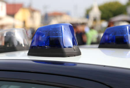 police: Blue sirens of police car while patrolling in the city Stock Photo