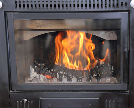 modern wood-burning stove to heat House in winter