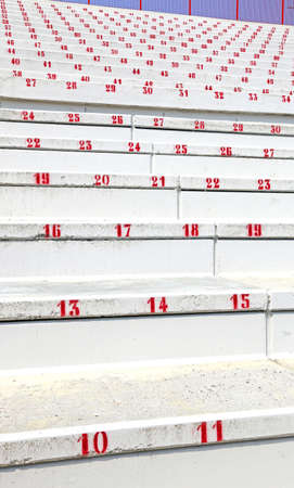 absent: numbered steps in stands of reinforced concrete of modern stadium before the sporting event
